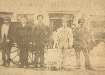 Joe Faro (circa 1875) stands with his pie oven (second from left)