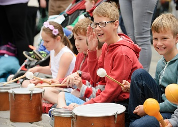 Children playing musical instruments during story time