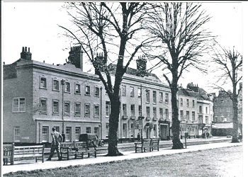 View of the Dolphin and Anchor hotel from in front of the Cathedral in the 1950s or 1960s.