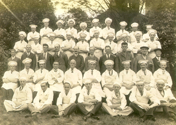 A photograph of Shippam's employees wearing their distinctive overalls