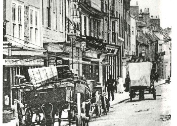 Street view of North Street 1900, showing the Smith Brothers House, second from left